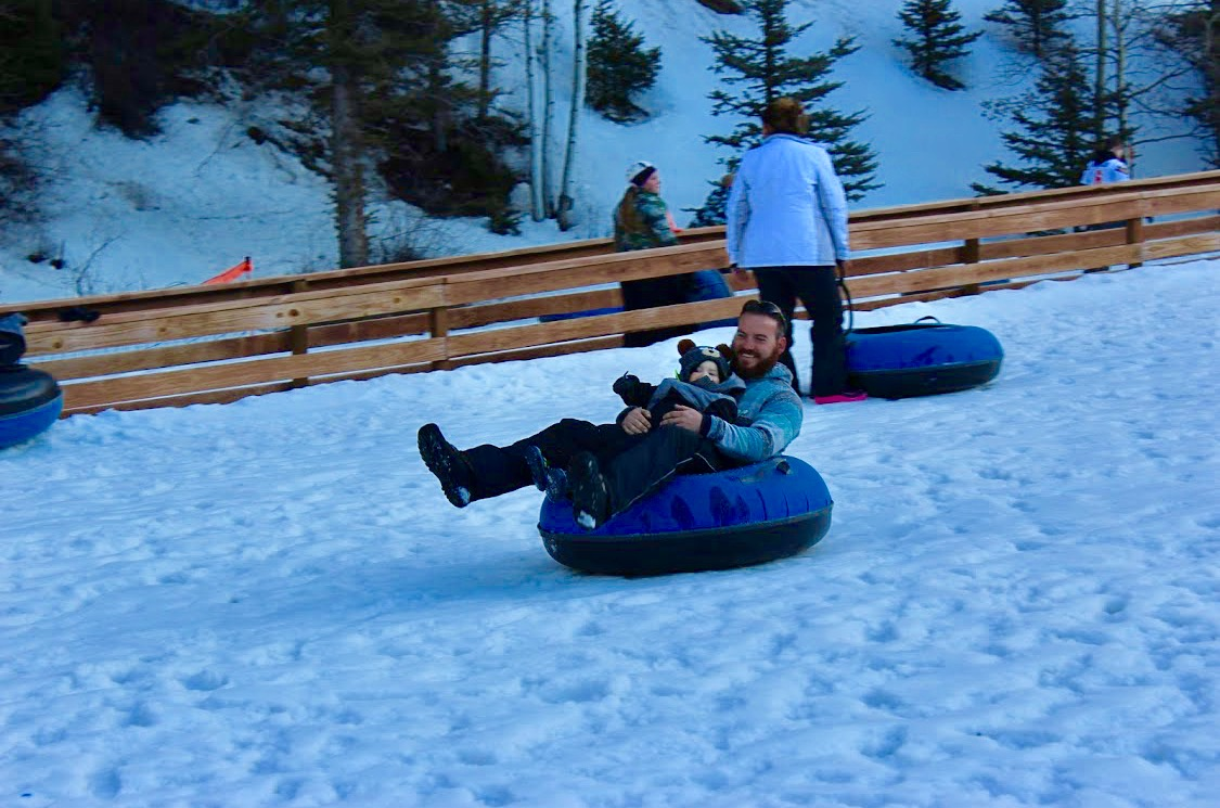 playing in snow tubing by Kenneth Cawthon